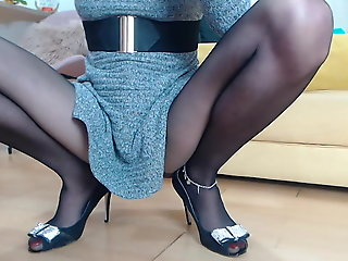 Lady with long legs wearing pantyhose masturbate