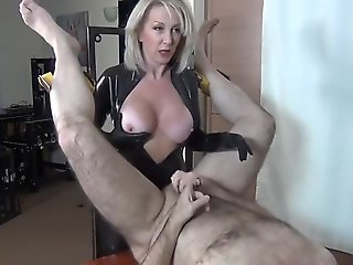 mistress in latex fucks guy with strapon